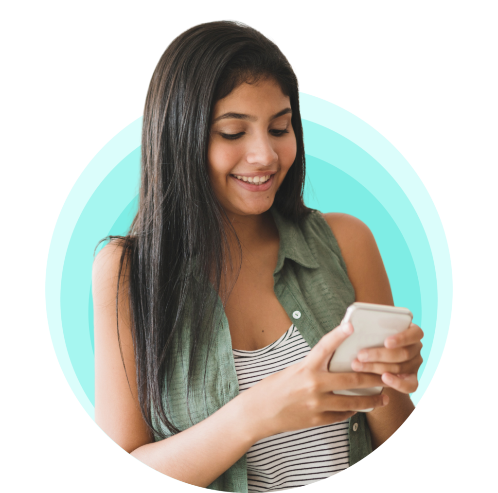 A happy girl with long hair leaning to her side and smiling as she uses the OKY app on her smartphone